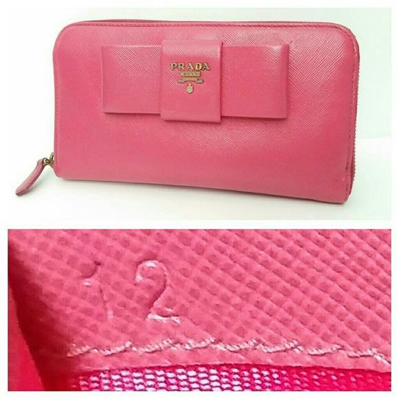 17f51e1b8762c8 Authentic Prada Saffiano Zip-Around Leather Wallet.  M_5c79b5d703087cecb7f8b39c